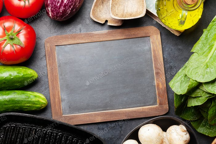 Cooking utensils, ingredients and chalkboard