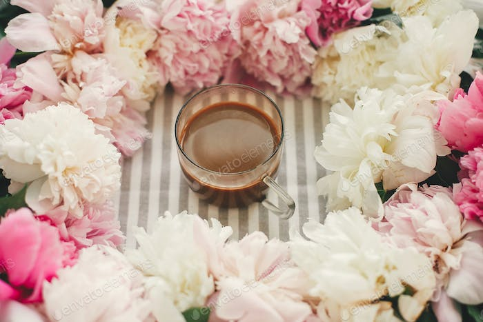 Coffee drink in glass cup in beautiful pink and white peonies frame