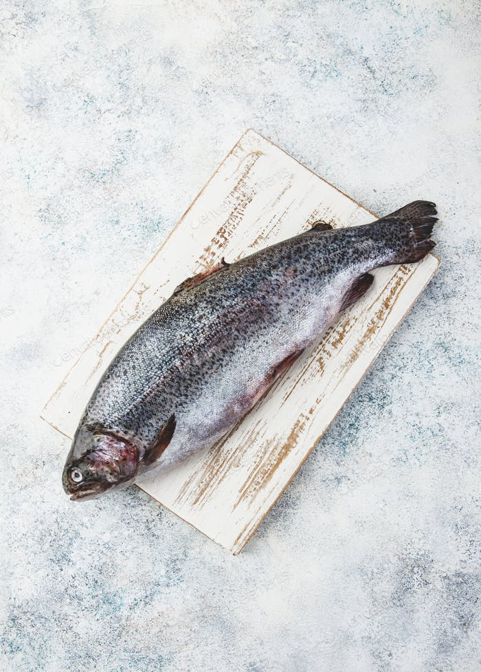 Raw rainbow trout light background