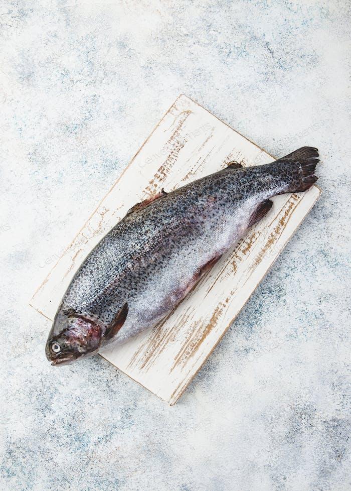 Raw rainbow trout light background
