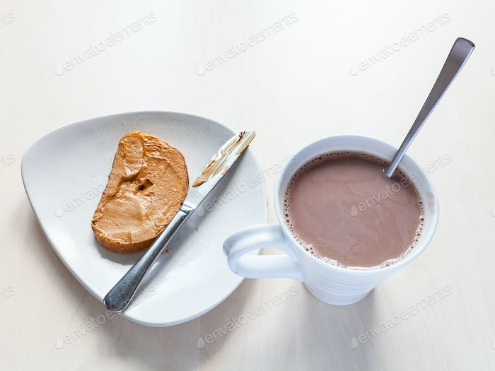 mug with chocolatte and toast with peanut butter