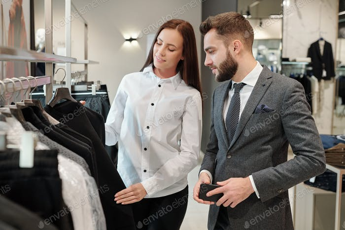 Fashion consultant giving advice to man