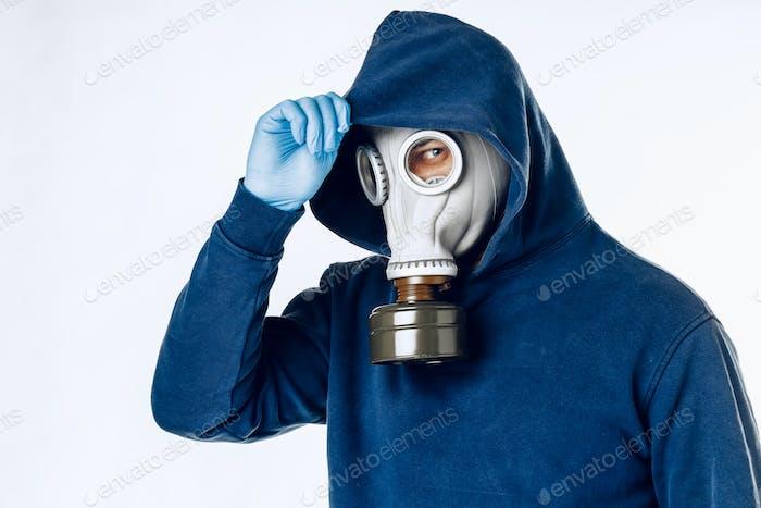 Portrait of a man in a gas mask. Panic during quarantine. Coronavirus pandemia