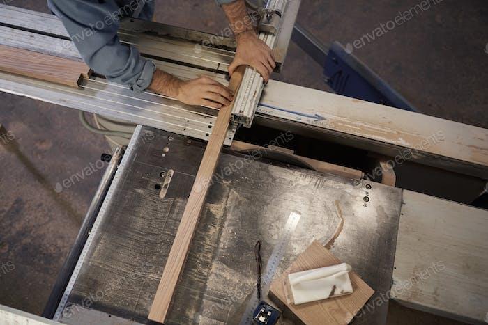Man cutting the plank