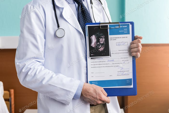 Partial view of man doctor holding clipboard with medical diagnosis and ultrasound scan