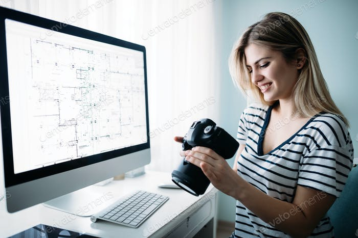 Young designer working on project at home
