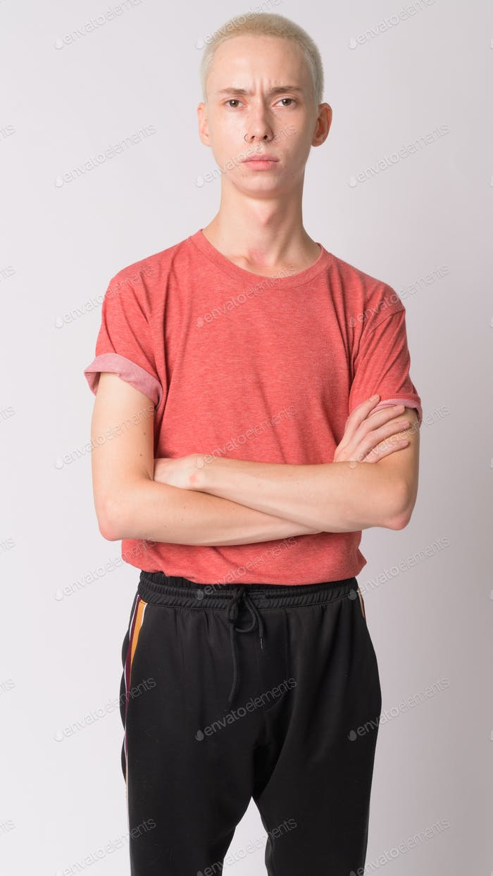 Portrait of young handsome androgynous man with arms crossed