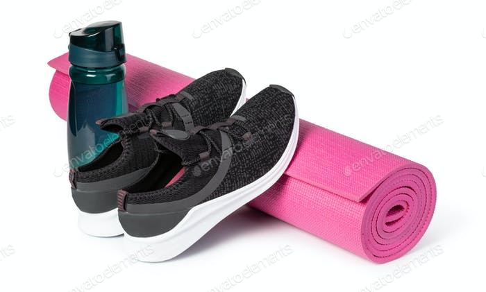 Sport shoes and yoga mat