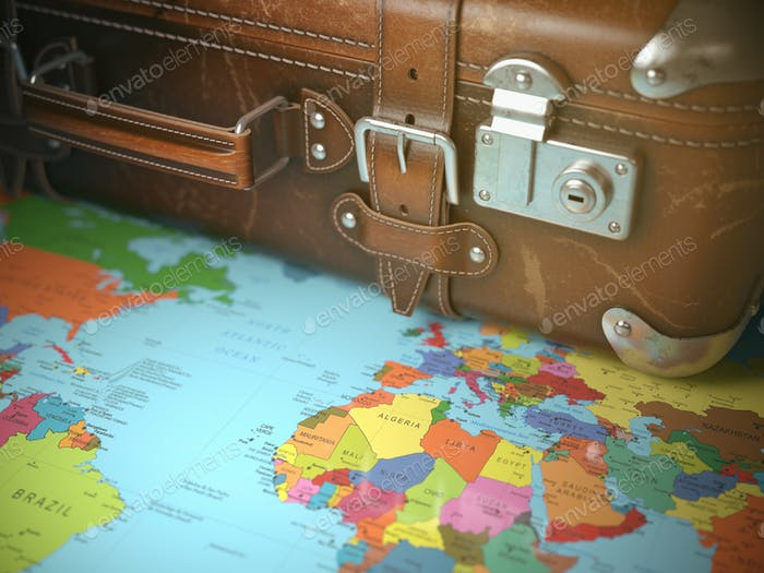 Travel and vacations background concept. Vintage suitcase on the