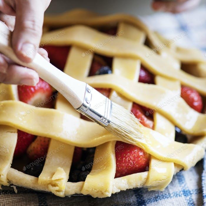 A person baking fruit pie food photography recipe idea