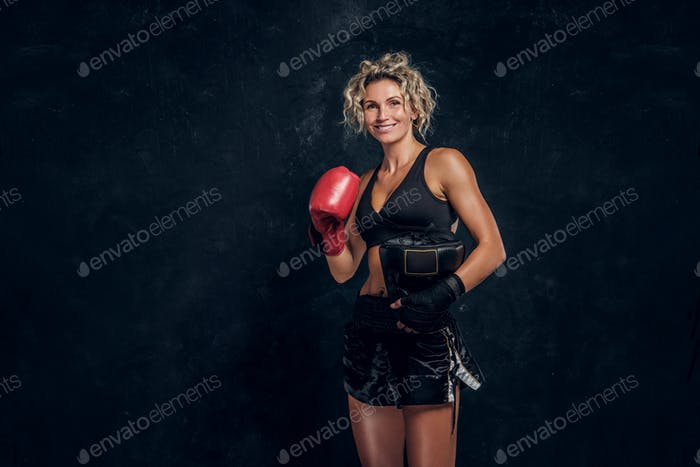 Portrait of expirienced female boxer in photo studio