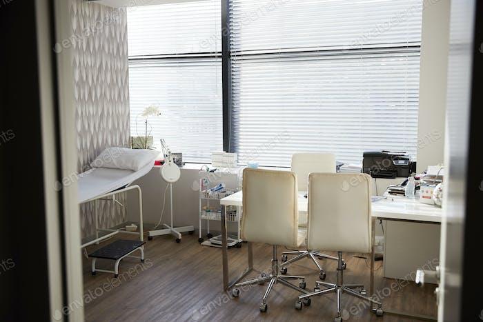 Empty Doctors Office Viewed Through Open Door