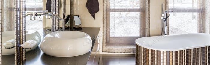 Bathroom with bathtub and sink