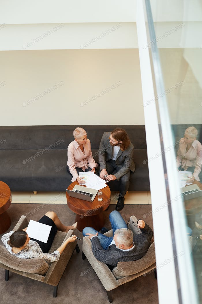 People Meeting in Business Lobby