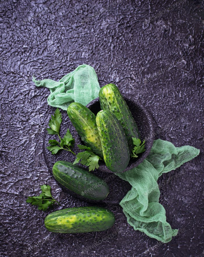 Fresh cucumbers on concrete background