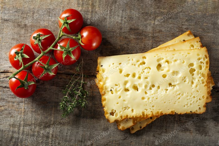 Three slices of scheiben cheese with cherry tomatoes
