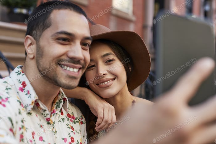 Couple Posing For Selfie On Street In New York City