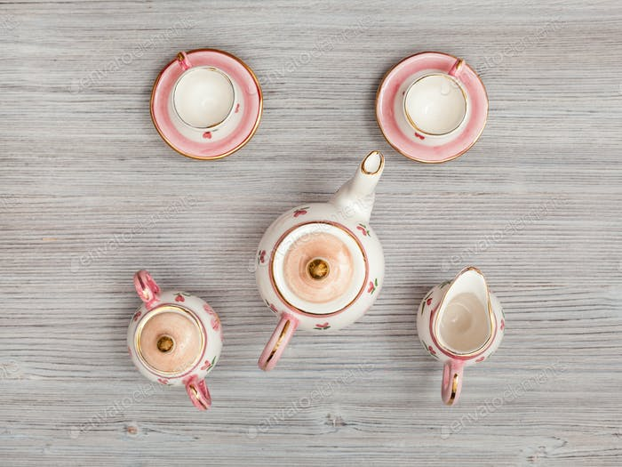pink porcelain tea set on gray brown table