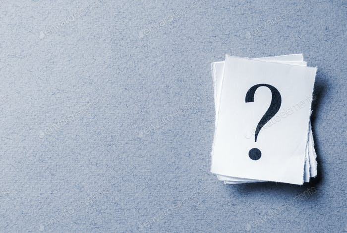Single curled card with printed question mark