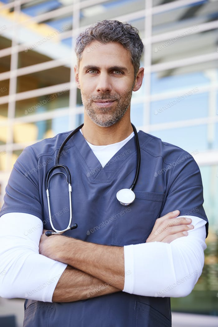 Middle aged white male healthcare worker outdoors, vertical