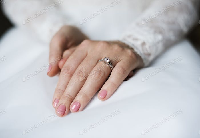 Attractive Beautiful Bride Showing Engagement Wedding Ring on Ha