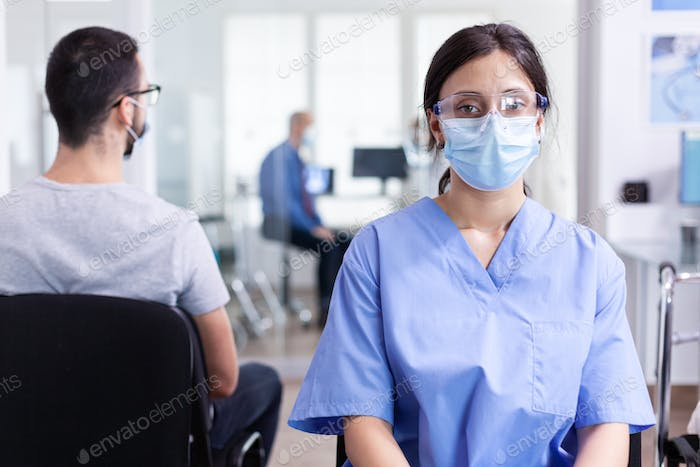 Medical assistant with visor and face mask
