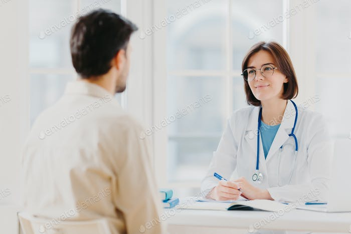 Cardiologist in eyewear gives medical consultation diagnostic, advice for man how to cure disease