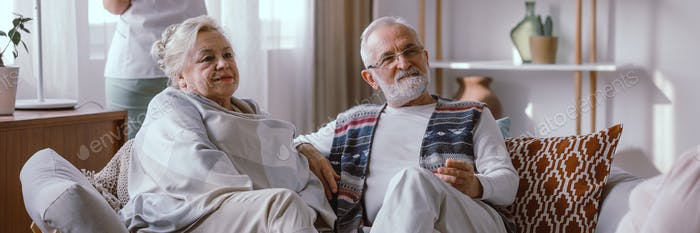 Elderly couple sitting on the sofa in the nursing home