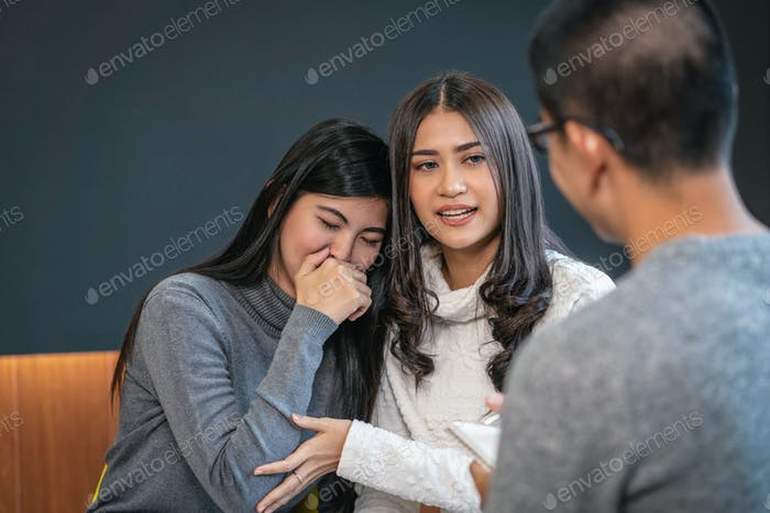 Asian male professional psychologist doctor giving the consult to lovers patients