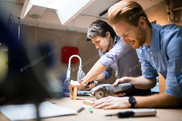 Two creative designers working in workshop