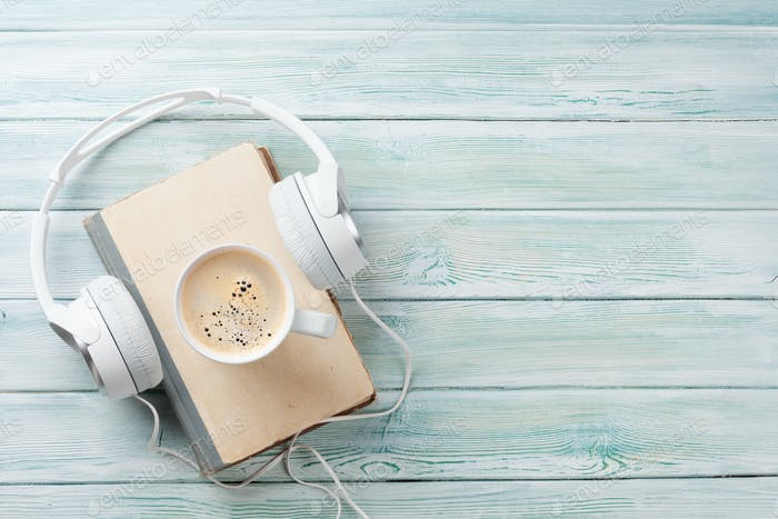 Audio book concept. Headphones, coffee and book
