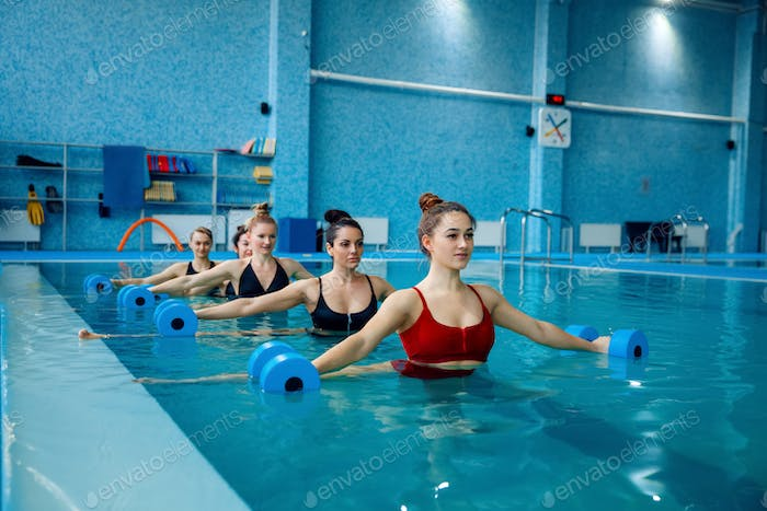 Aqua aerobics, exercise with dumbbells in the pool