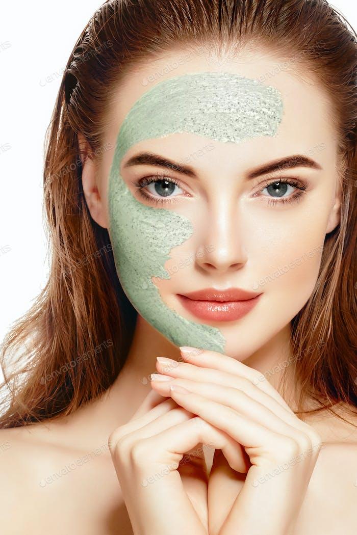 Woman spa mask half-face beauty concept healthy portrait. Studio shot.