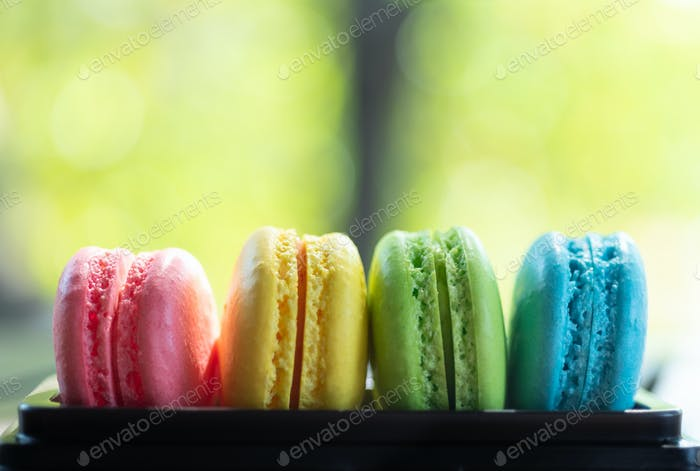 Colorful macaroons on tray