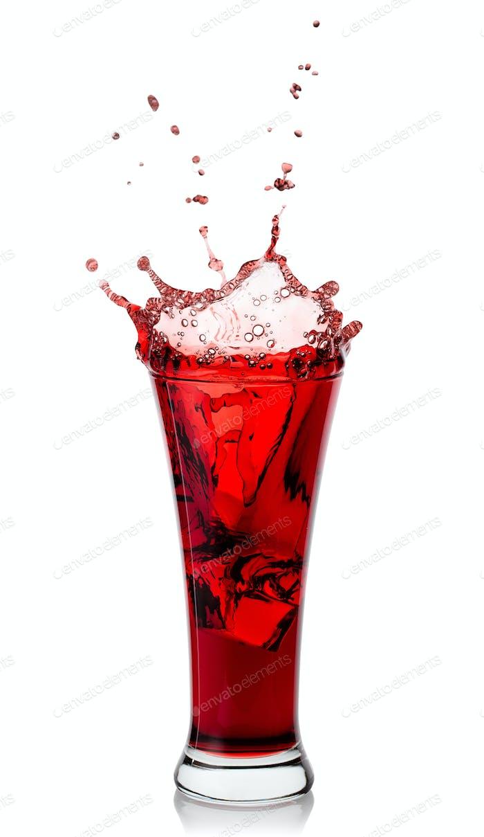 Splash of fragrant natural juice in high transparent glass