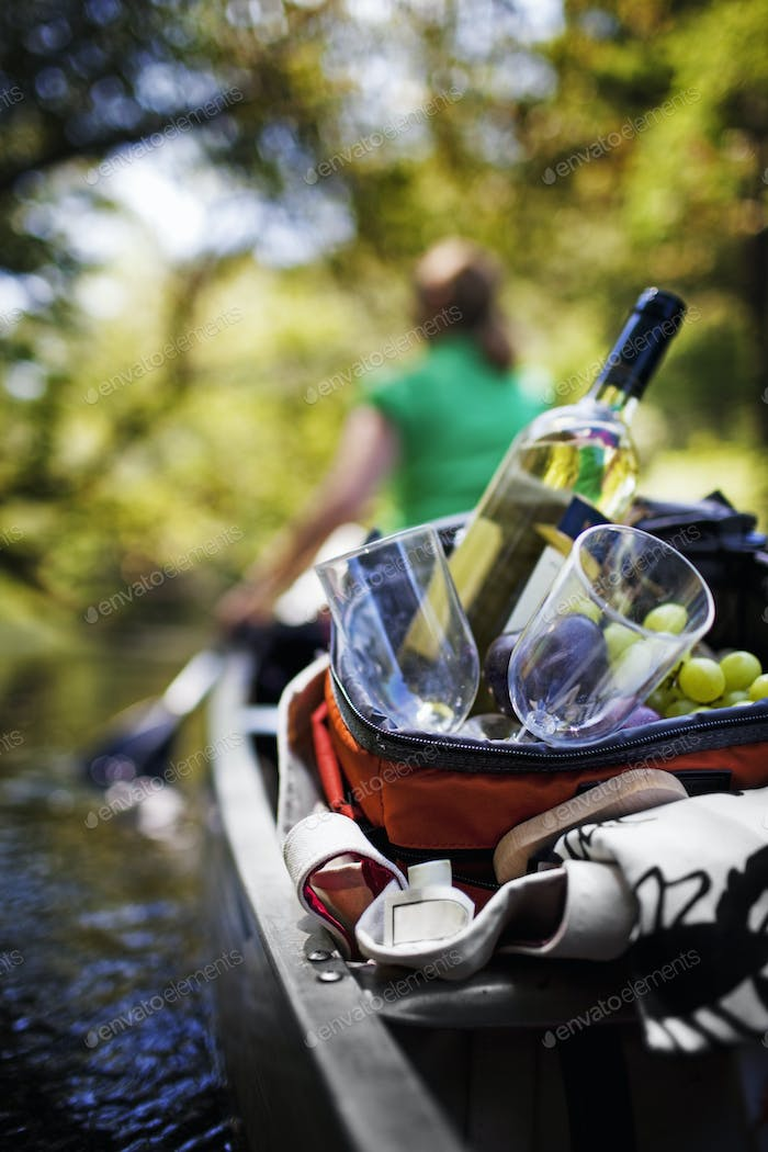 Woman canoeing with picnic