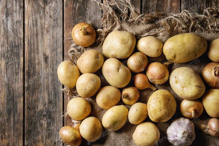 Raw organic potatoes and onion