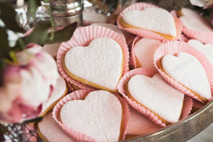 Heart shaped cookies with pink icing, closeup