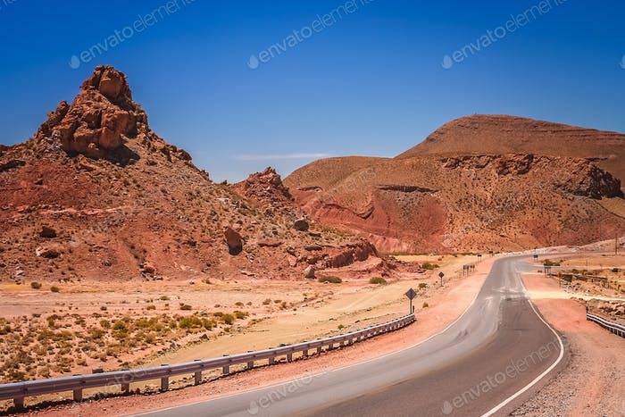 Road through the dry and barren mountain landscape