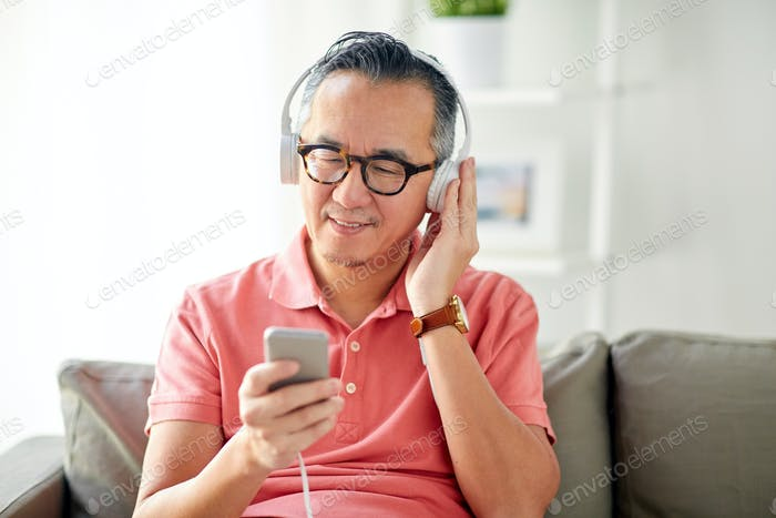 man with smartphone and headphones at home