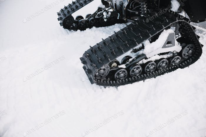 close up on ratrak wheels on the snow