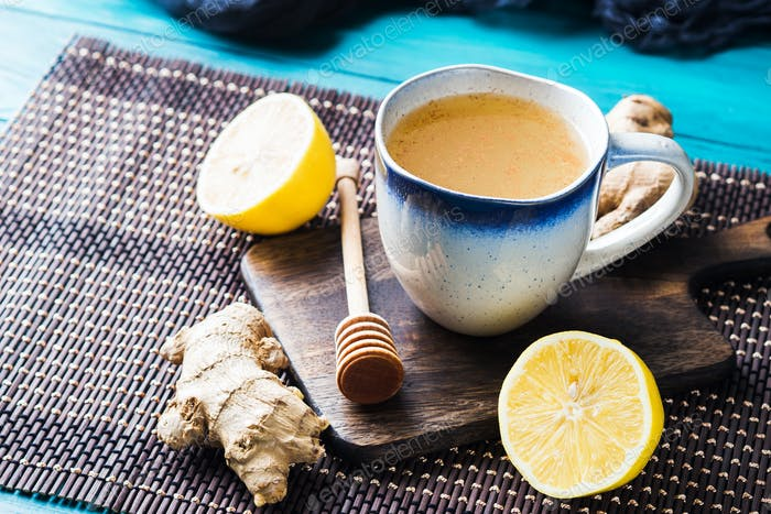Lemon ginger hot tea drink with honey as natural remedy