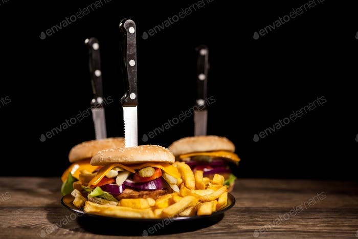 Tasty gourmet delicous burgers on black plate