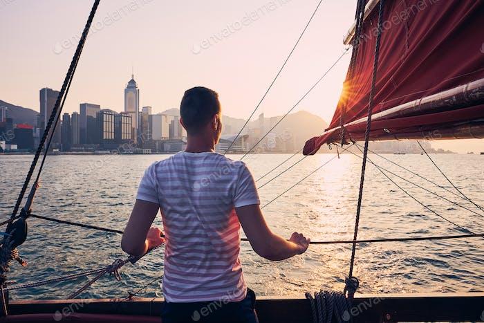 Traveler on traditional junk boat