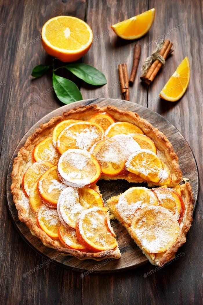 Fruit tart with orange caramelized slices