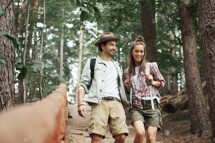 Young couple walking through forest
