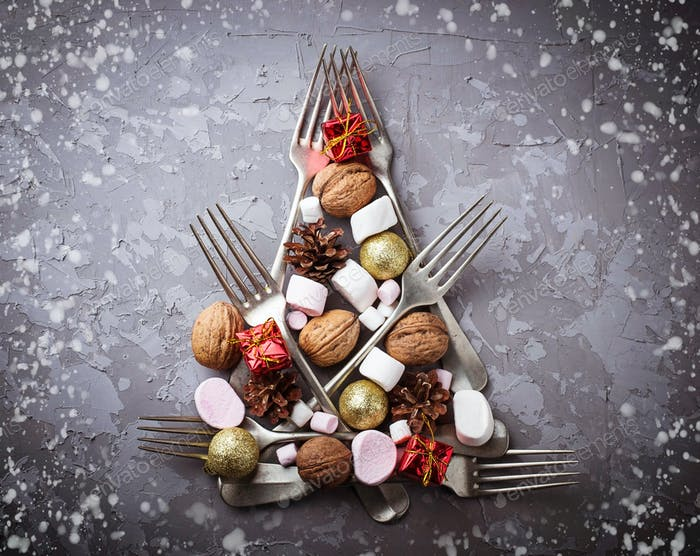 Christmas tree made of forks, nuts and marshmallow