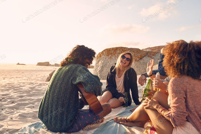Group of friends having fun at the beach party