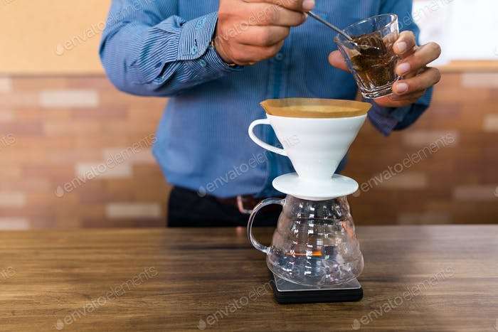 Barista making of hand drip coffee