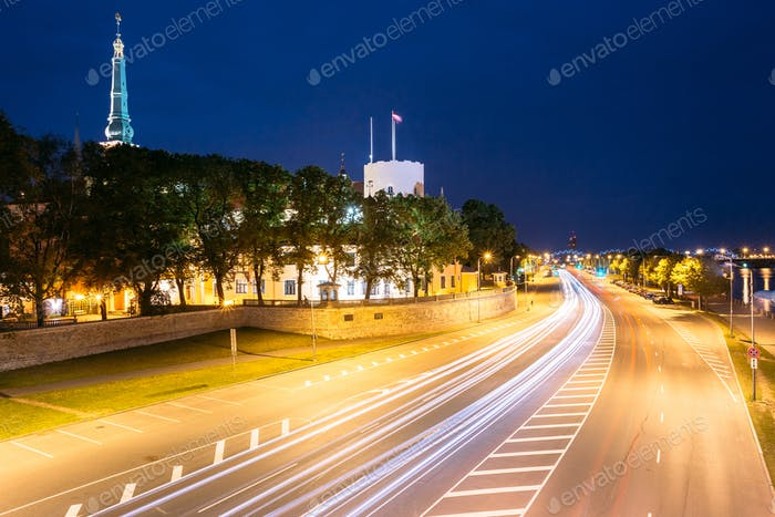 Riga Latvia. Night View Of 11 November Embankment In Bright Illu